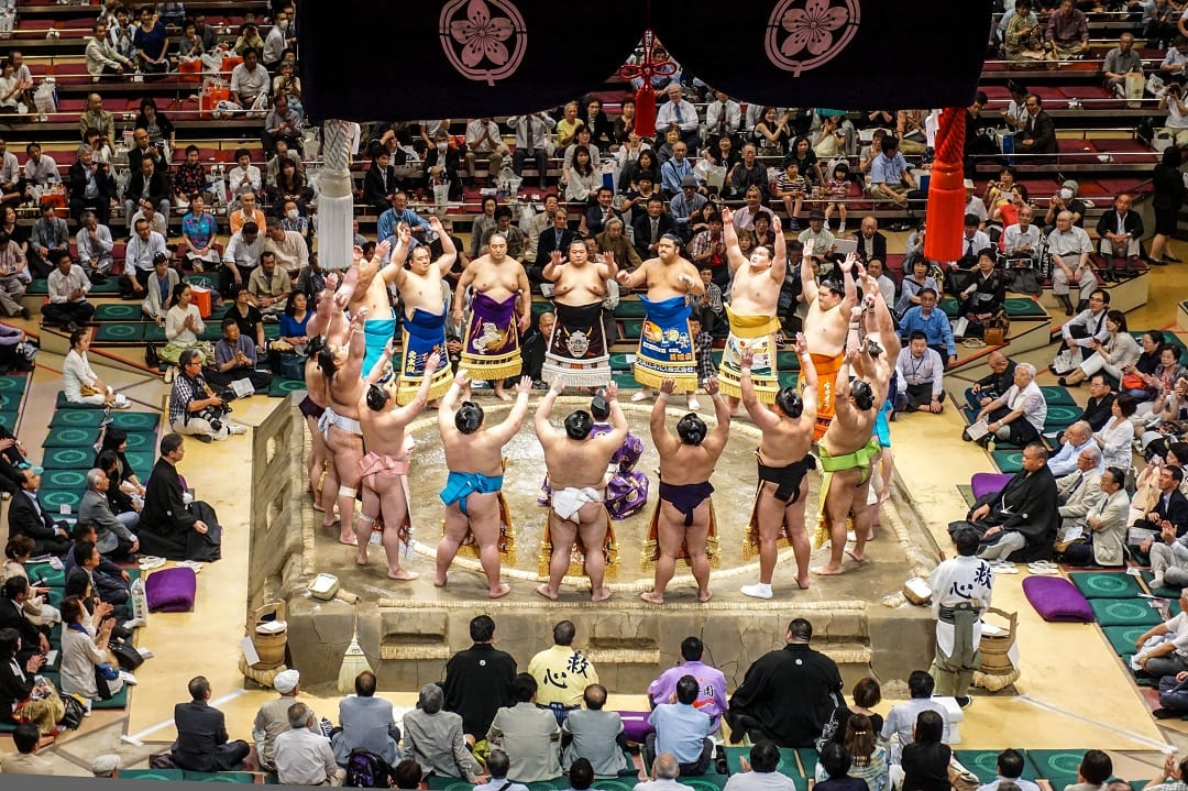 The Yokozuna class of sumos saluting each other
