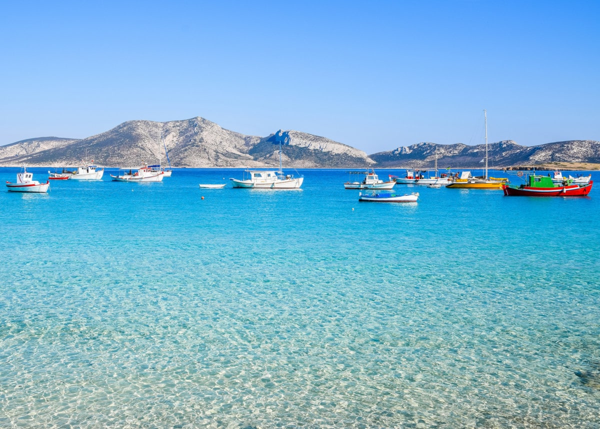 Image result for Traditional fishing boats bob in the shallows of Koufonisia, the best-known of the Small Cyclades