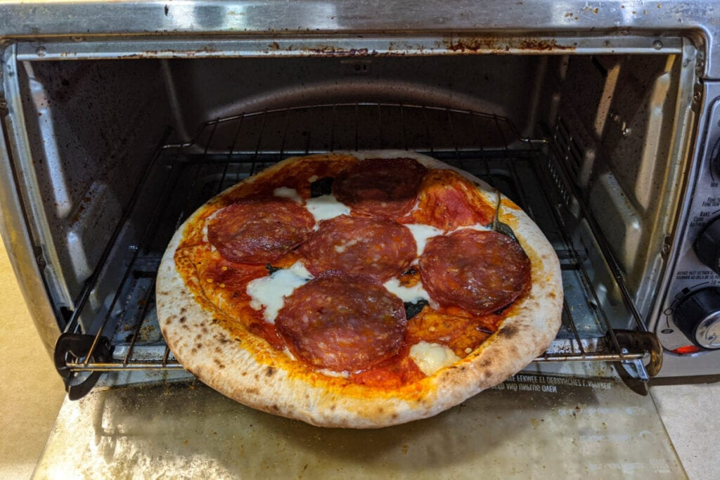 Pizza cooked in a mini oven